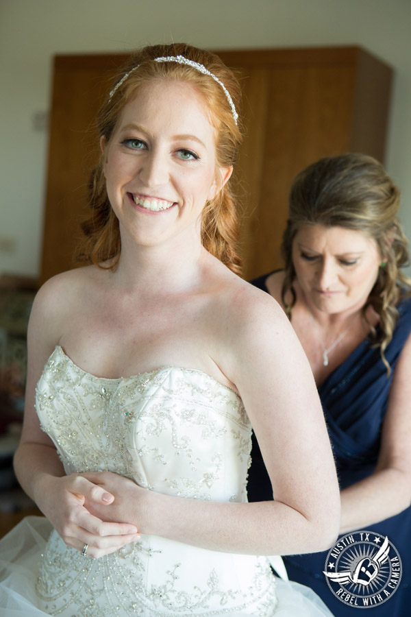 Fun Wedding Pictures at TerrAdorna in Austin, Texas - mother of bride laces up wedding dress corset - hair and makeup by ATX Bridal Beauty