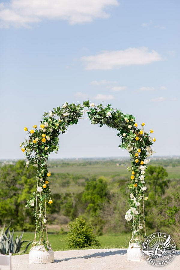 Fun Wedding Pictures at TerrAdorna in Austin, Texas - arbor decorated with yellow roses at the ceremony site