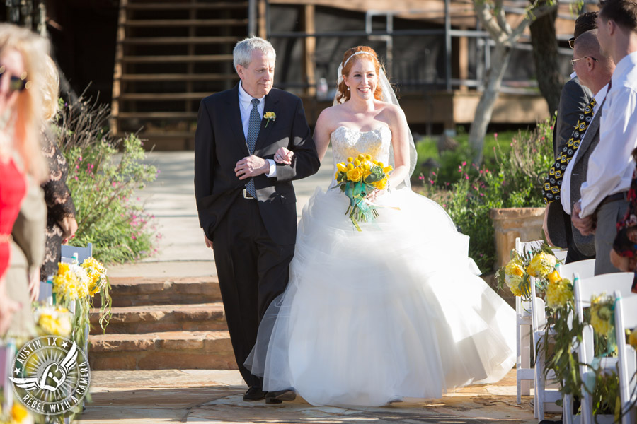 Fun Wedding Pictures at TerrAdorna in Austin, Texas - bride walks down the aisle with her father during the ceremony