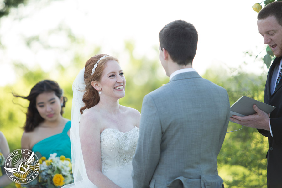 Fun Wedding Pictures at TerrAdorna in Austin, Texas - bride and groom say vows during the wedding ceremony