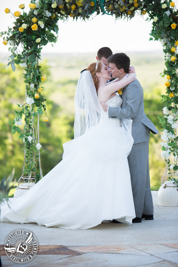 Fun Wedding Pictures at TerrAdorna in Austin, Texas - bride and groom kiss at the end of the wedding ceremony