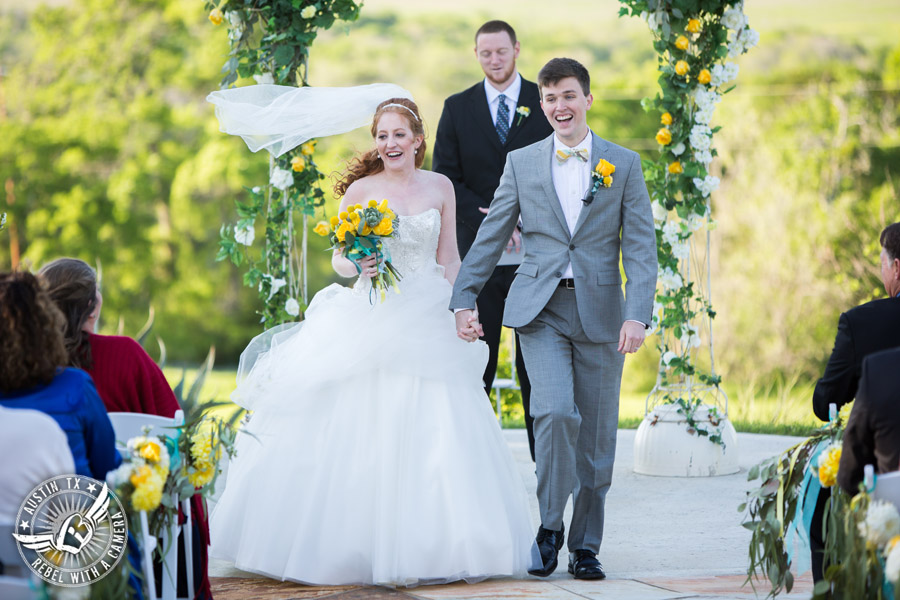 Fun Wedding Pictures at TerrAdorna in Austin, Texas - bride and groom walk down the aisle at the end of the wedding ceremony