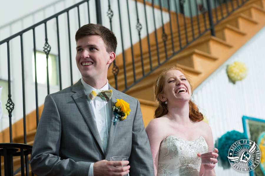 Fun Wedding Pictures at TerrAdorna in Austin, Texas - bride and groom laugh during toasts at wedding reception