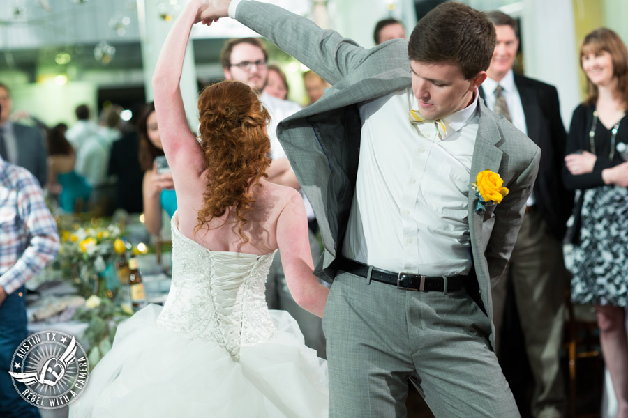 Fun Wedding Pictures at TerrAdorna in Austin, Texas - bride and groom dance their first dance at wedding reception with Greenbelt DJ