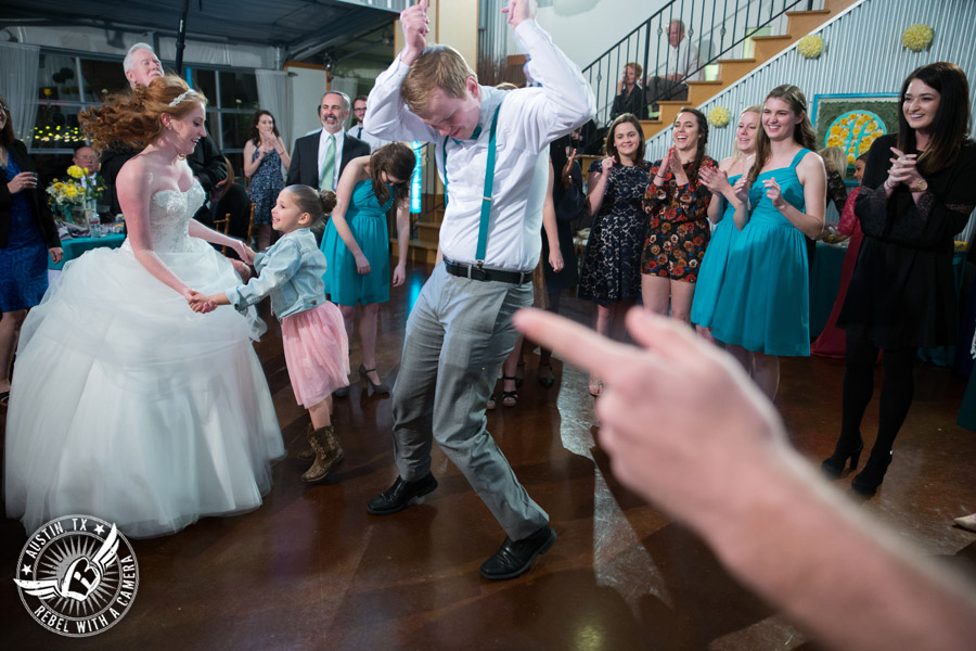Fun Wedding Pictures at TerrAdorna in Austin, Texas - guests dance at wedding reception with Greenbelt DJ