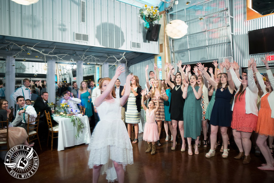 Fun Wedding Pictures at TerrAdorna in Austin, Texas -throws bouquet to all the single ladies at the wedding reception with Greenbelt DJ