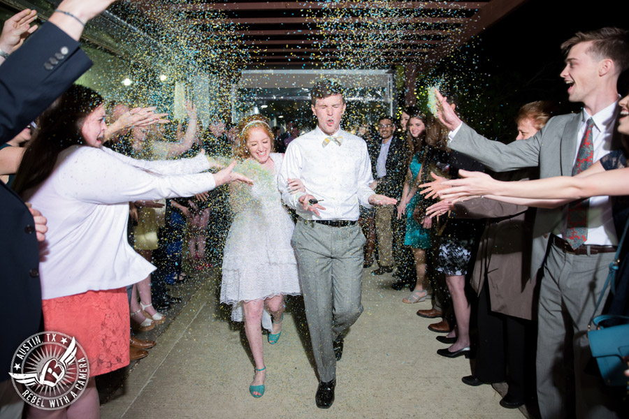 Fun Wedding Pictures at TerrAdorna in Austin, Texas - bride and groom exit the wedding reception as guests throw Ecofetti