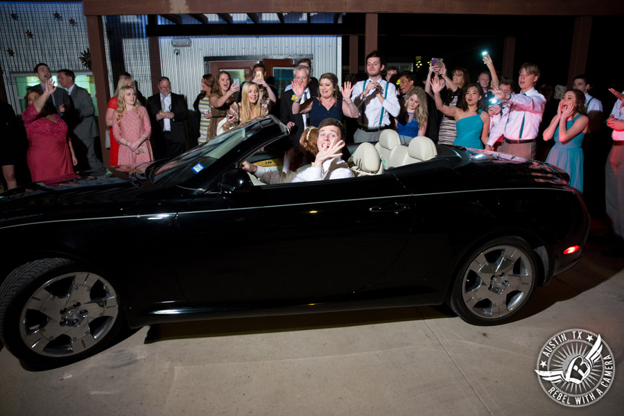 Fun Wedding Pictures at TerrAdorna in Austin, Texas - bride and groom wave goodbye to guests as they drive off in exit car