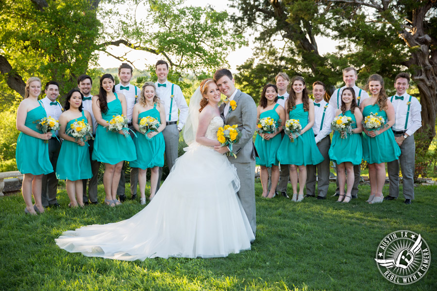Fun Wedding Pictures at TerrAdorna in Austin, Texas - bride and groom with wedding party - bridesmaids in turquoise dresses with yellow bouquets
