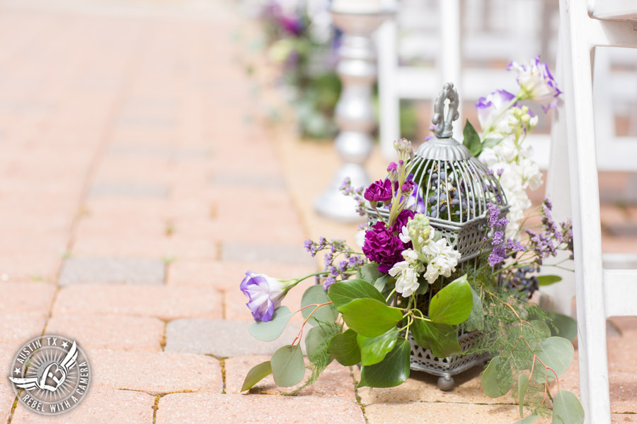 Lake Travis wedding pictures in Austin, Texas - Nature's Point bride's ceremony aisle with flowers by Visual Lyrics
