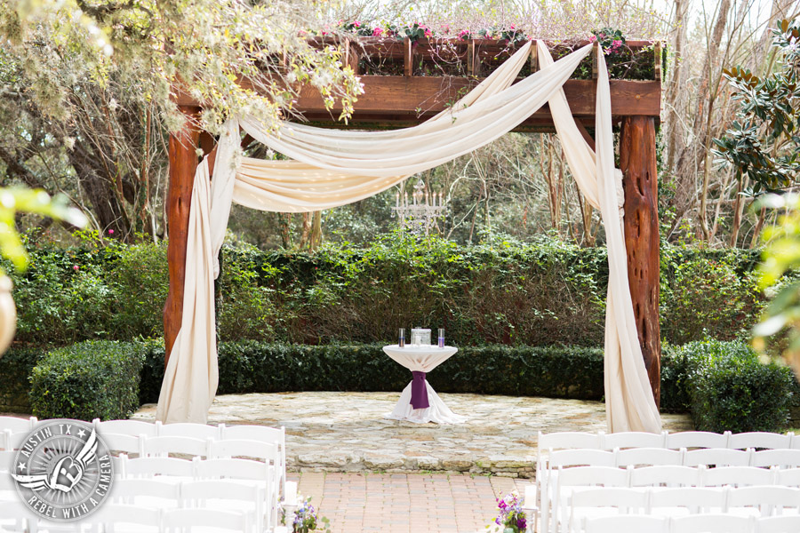 Lake Travis wedding pictures in Austin, Texas - Nature's Point bride's ceremony arbor with flowers by Visual Lyrics