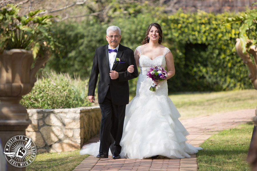 Lake Travis wedding pictures in Austin, Texas - Nature's Point - bride and her father walk down the aisle during wedding ceremony with bouquet by Visual Lyrics
