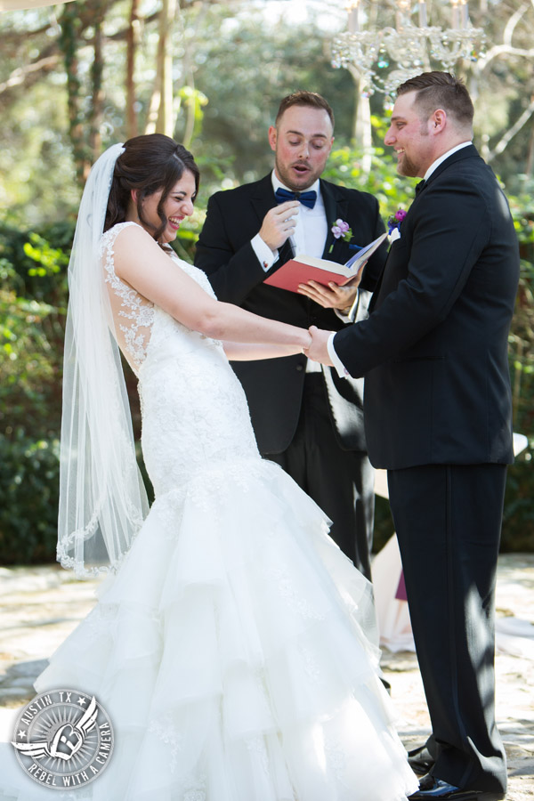 Lake Travis wedding pictures in Austin, Texas - Nature's Point - bride and groom say vows during wedding ceremony