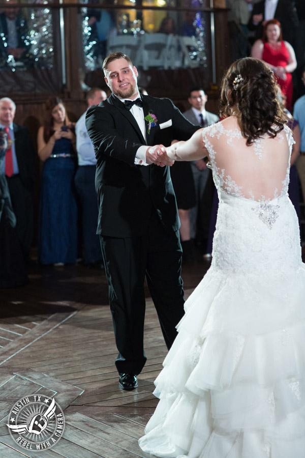 Lake Travis wedding pictures in Austin, Texas - Nature's Point - bride and groom dance their first dance on the deck