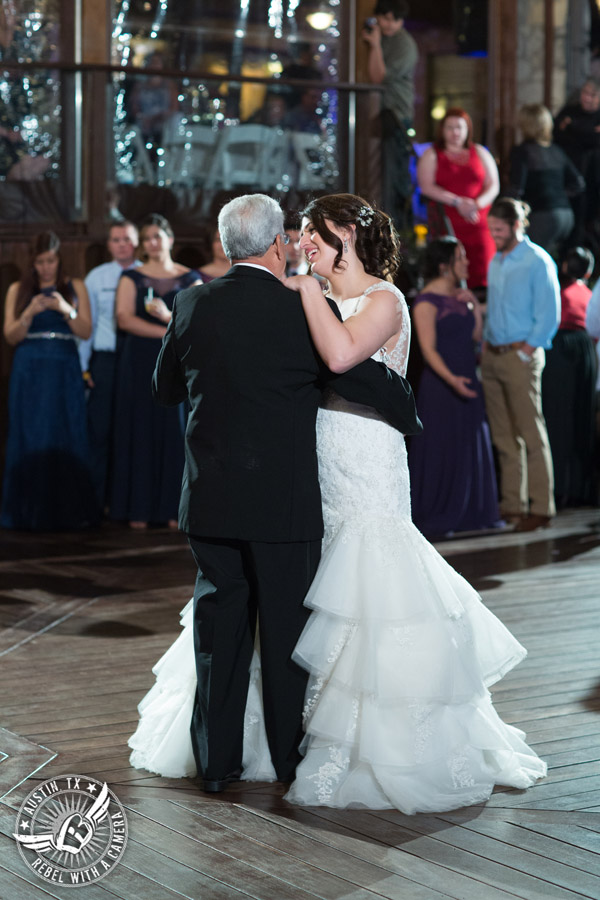 Lake Travis wedding pictures in Austin, Texas - Nature's Point - bride dances with her father on the deck