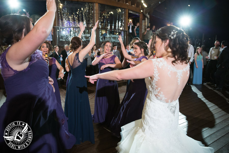Lake Travis wedding pictures in Austin, Texas - Nature's Point - guests dance during the wedding reception on the deck