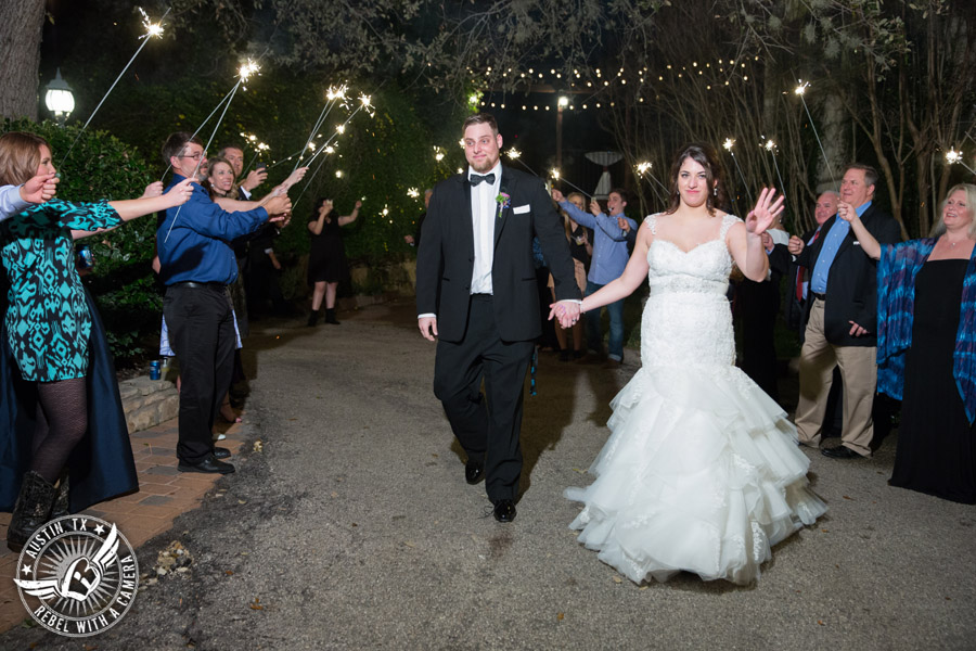 Lake Travis wedding pictures in Austin, Texas - Nature's Point - bride and groom leave the wedding to sparker exit
