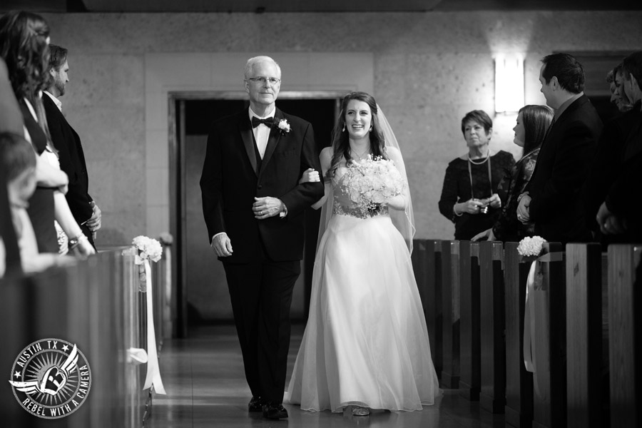 Wedding photography of bride and her father walking down the aisle at the St. Austin's Church