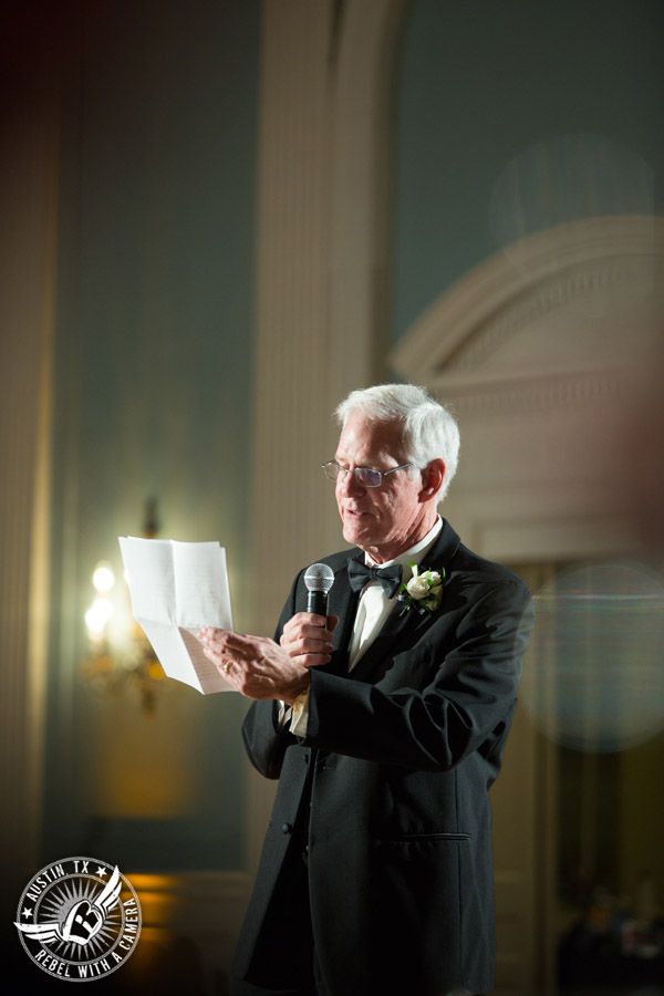 Winter wedding photos at the Texas Federation of Women's Clubs Mansion - father of the bride gives toast at the wedding reception in the ballroom