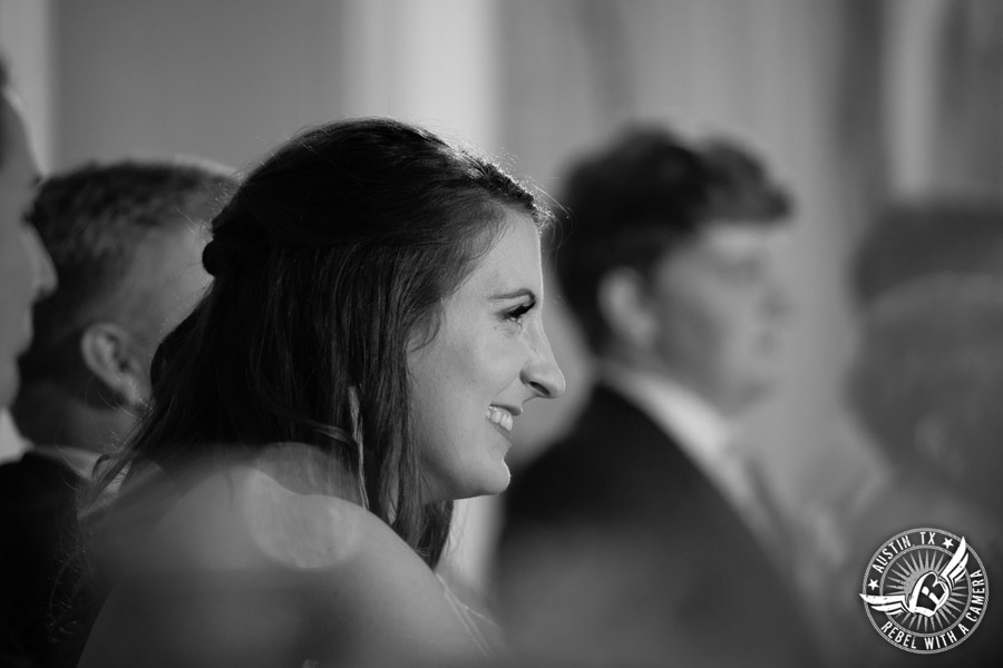 Winter wedding photos at the Texas Federation of Women's Clubs Mansion - bride listens to her father give toast at the wedding reception in the ballroom