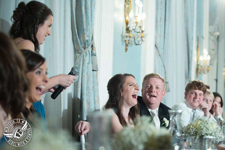 Winter wedding photos at the Texas Federation of Women's Clubs Mansion - bride and groom laugh while maid of honor gives toast at the wedding reception in the ballroom