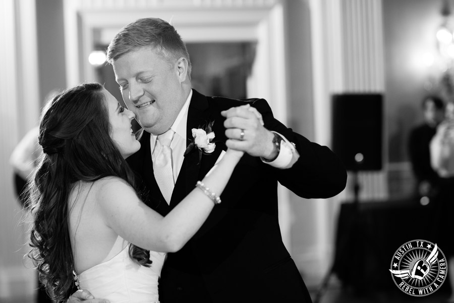Winter wedding photos at the Texas Federation of Women's Clubs Mansion - bride and groom's first dance at the wedding reception in the ballroom with DJ Byrne Rock