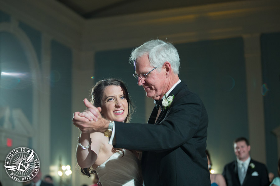 Winter wedding photos at the Texas Federation of Women's Clubs Mansion - bride dances with father at the wedding reception in the ballroom with DJ Byrne Rock