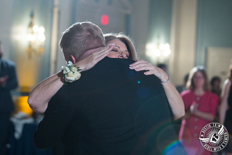 Winter wedding photos at the Texas Federation of Women's Clubs Mansion - groom dances with his mom at the wedding reception in the ballroom with DJ Byrne Rock