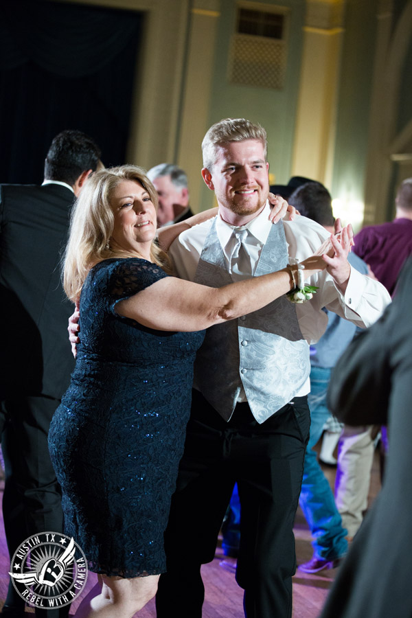 Winter wedding photos at the Texas Federation of Women's Clubs Mansion - guests dance at the wedding reception in the ballroom with DJ Byrne Rock