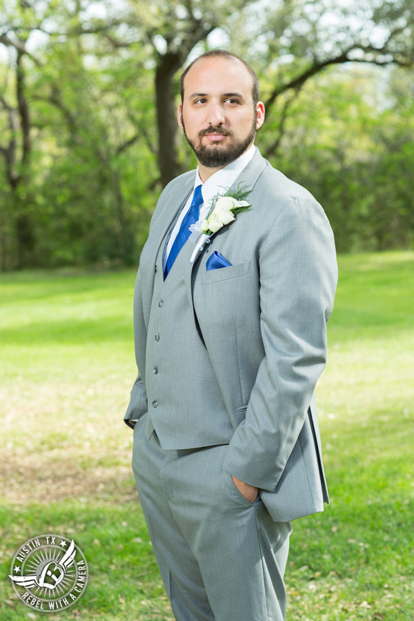 Fun wedding photographer at Kindred Oaks in Austin, Texas - groom in grey suit and royal blue tie