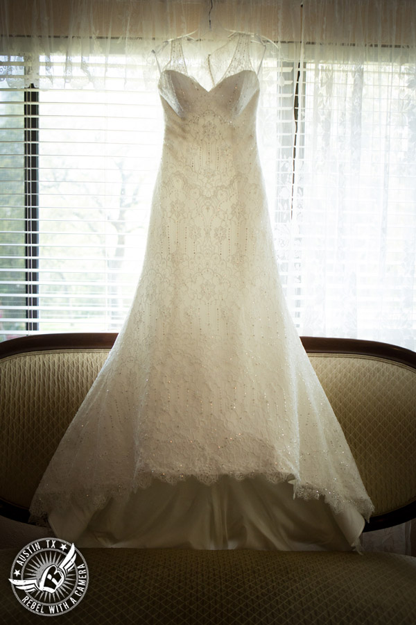 Fun wedding photographer at Kindred Oaks in Austin, Texas - Jasmine wedding gown from Signature Bridal Salon in the bride's room
