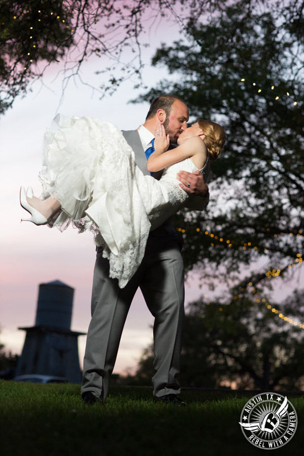 Fun wedding photographer at Kindred Oaks in Austin, Texas - bride and groom kiss in the sunset