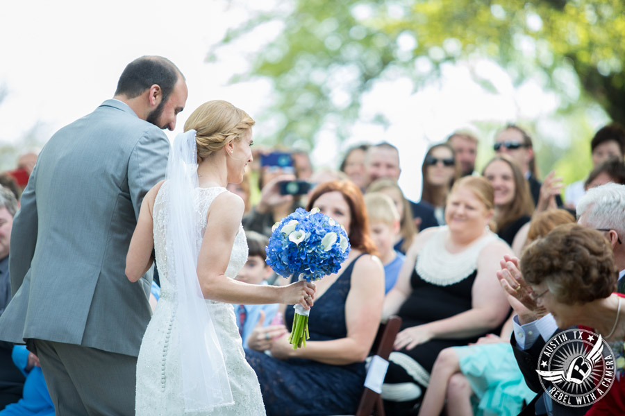 Fun wedding photographer at Kindred Oaks in Austin, Texas - bride and groom walk down the aisle at the end of the ceremony
