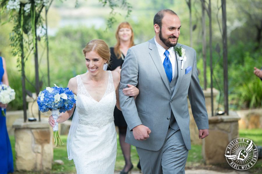 Fun wedding photographer at Kindred Oaks in Austin, Texas - bride and groom walk down the aisle at the end of the ceremony with Sarah Reed wedding officiant of Let's Do it Vows