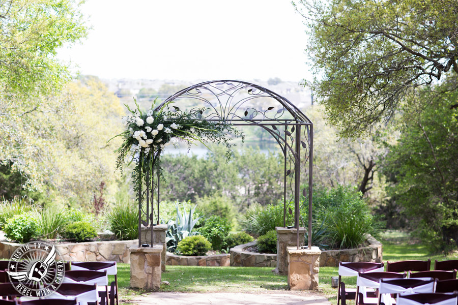 Fun wedding photographer at Kindred Oaks in Austin, Texas - ceremony arbor