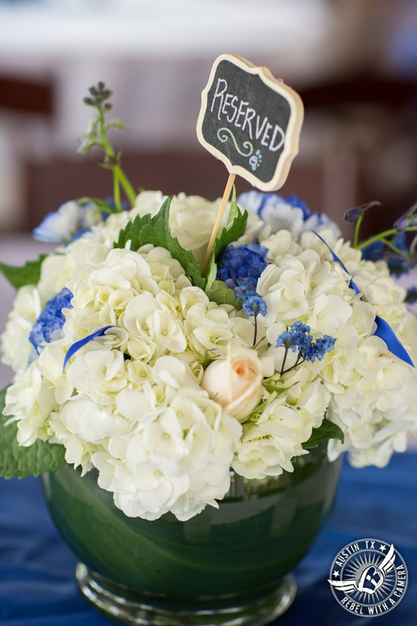 Fun wedding photographer at Kindred Oaks in Austin, Texas - hydrangea and rose floral centerpiece by Shooting Star Floral