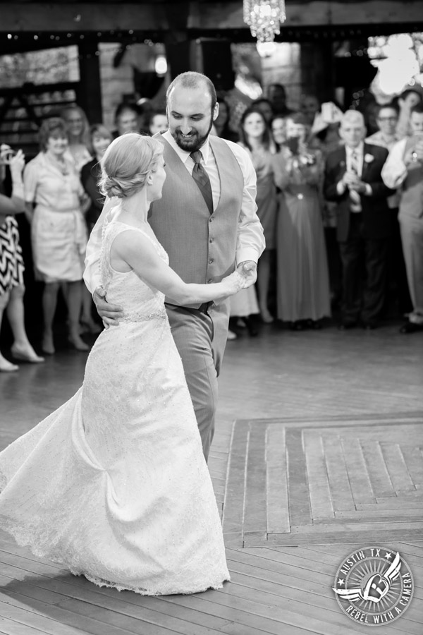 Fun wedding photographer at Kindred Oaks in Austin, Texas - bride and groom's first dance with Dexter Kyner, DJ for Hire