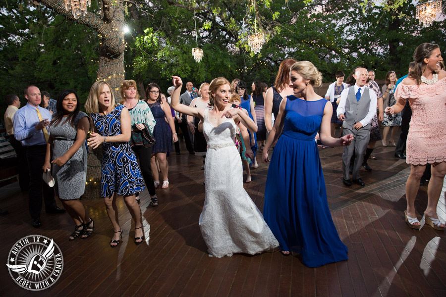 Fun wedding photographer at Kindred Oaks in Austin, Texas - guests dance to Dexter Kyner, DJ for Hire