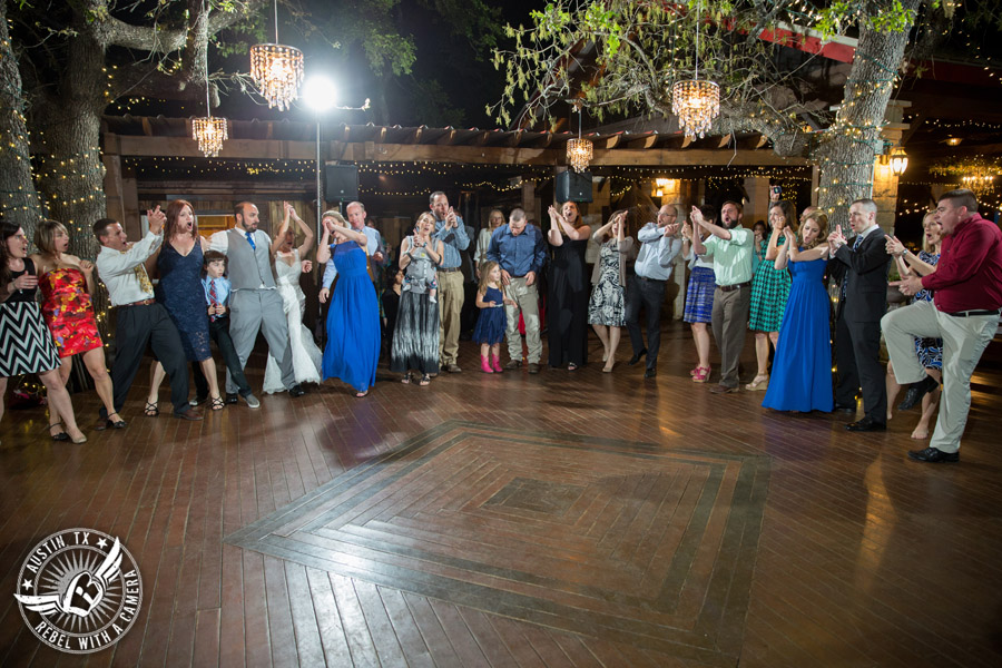 Fun wedding photographer at Kindred Oaks in Austin, Texas - Aggie guests dance to Dexter Kyner, DJ for Hire