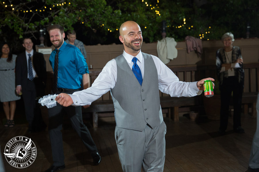 Fun wedding photographer at Kindred Oaks in Austin, Texas - single guys catch the garter with Dexter Kyner, DJ for Hire