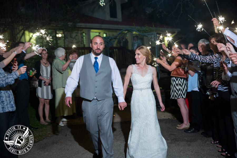 Fun wedding photographer at Kindred Oaks in Austin, Texas - bride and groom walk out to sparkler exit
