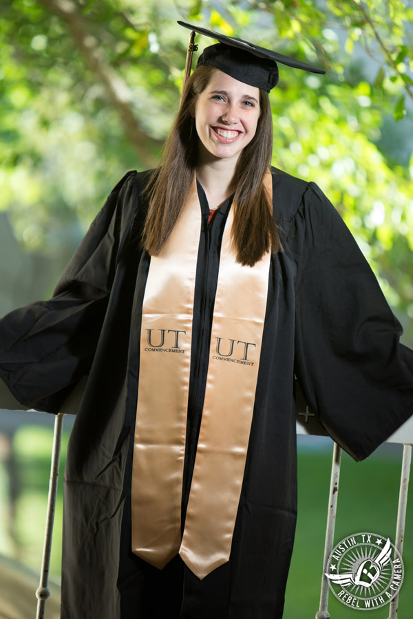 Longhorn graduation pictures on the UT Austin campus - graduate in cap and gown