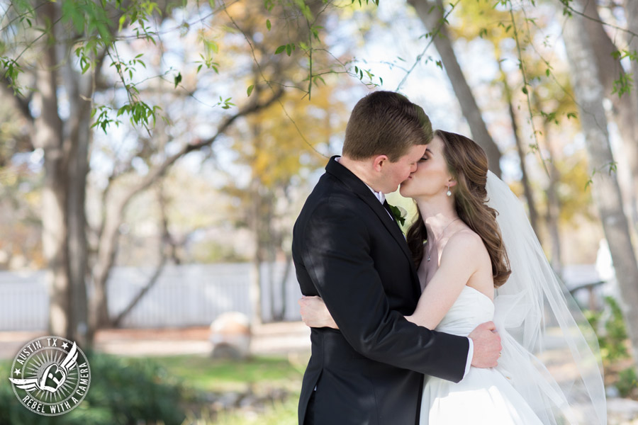 Elegant Casa Blanca on Brushy Creek wedding photos - bride and groom first look kiss