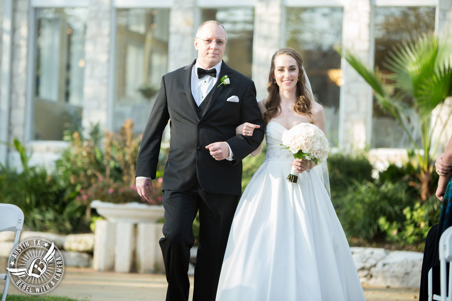 Elegant Casa Blanca on Brushy Creek wedding photos - bride and father walk down the aisle in wedding ceremony