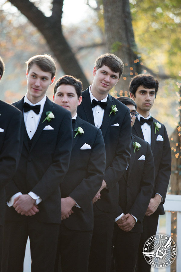 Elegant Casa Blanca on Brushy Creek wedding photos - groomsmen watch during wedding ceremony by Short and Sweet Weddings