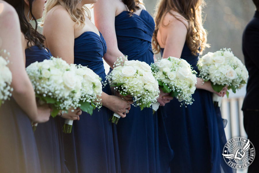Elegant Casa Blanca on Brushy Creek wedding photos - bridesmaids with bouquets by Bouquets of Austin during wedding ceremony by Short and Sweet Weddings
