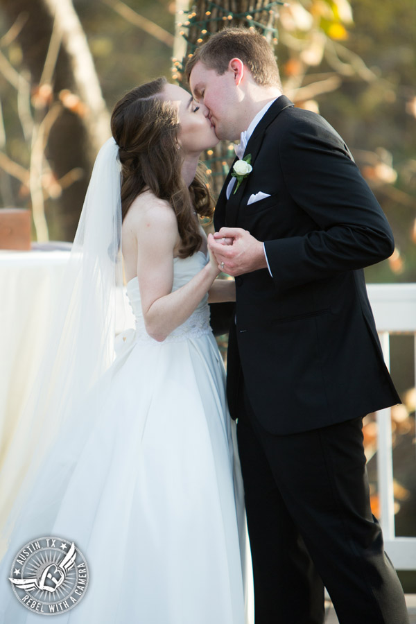 Elegant Casa Blanca on Brushy Creek wedding photos - LoLa Beauty - David's Bridal - bride and groom kiss during wedding ceremony