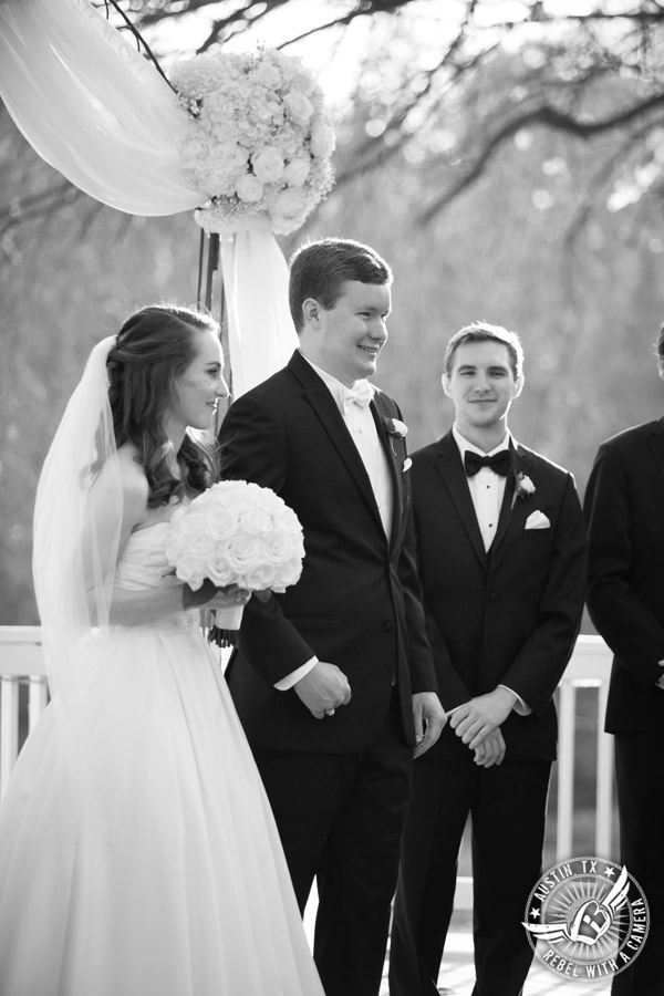 Elegant Casa Blanca on Brushy Creek wedding photos - LoLa Beauty - David's Bridal - bride and groom at end of wedding ceremony