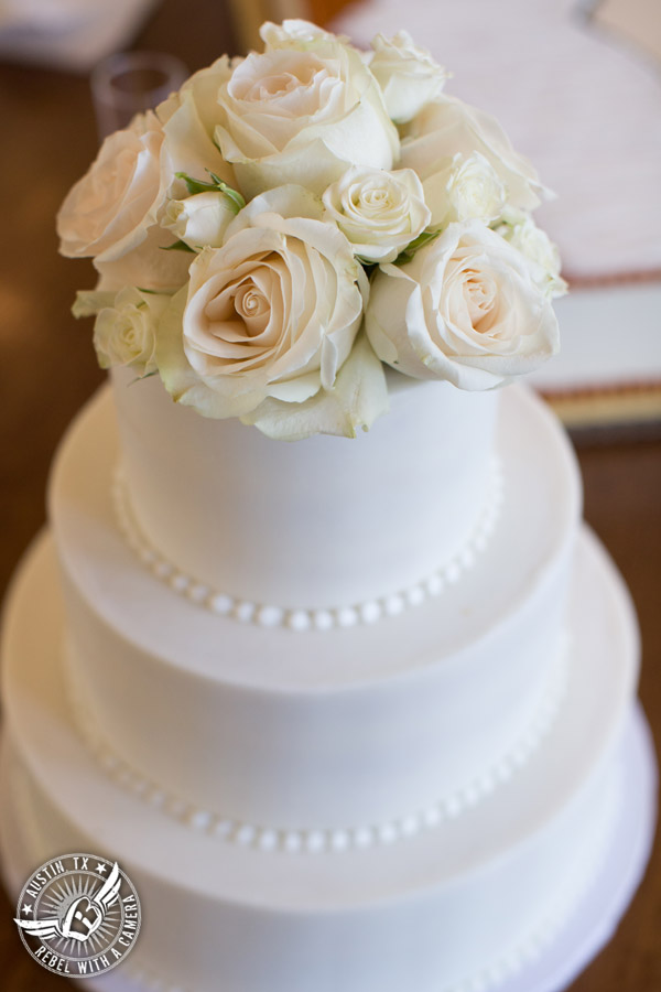 Elegant Casa Blanca on Brushy Creek wedding photos - buttercream wedding cake by Sweet Treets Bakery with florals from Bouquets of Austin for wedding reception