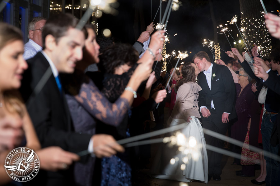 Elegant Casa Blanca on Brushy Creek wedding photos - bride and groom kiss while leaving wedding reception with sparkler exit